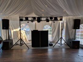 Tent wedding with large DJ booth setup